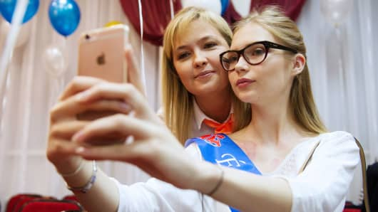 Students take a selfie ahead of celebrations of the Farewell Bell fest marking the end of classes before their final exams, Novosibirsk, Russia.