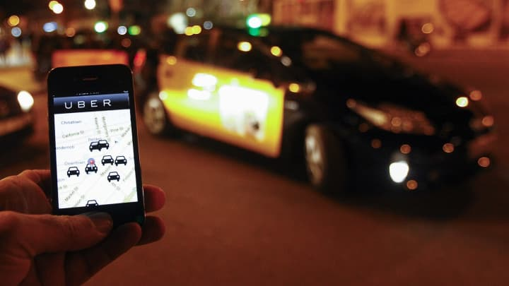 The Uber app on a smartphone by waiting cabs in Barcelona.
