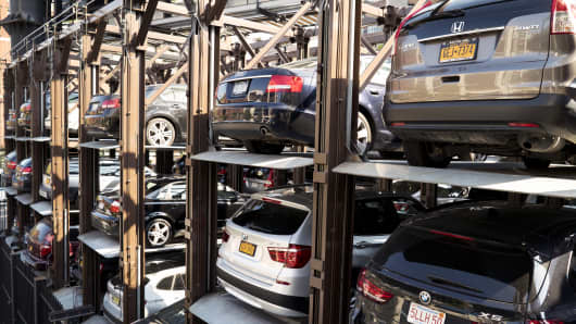 Cars parked in an elevated parking lot in New York City.