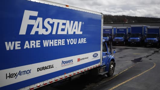 Delivery trucks sit parked at loading docks outside the Fastenal Co. distribution center in Jessup, Pennsylvania.