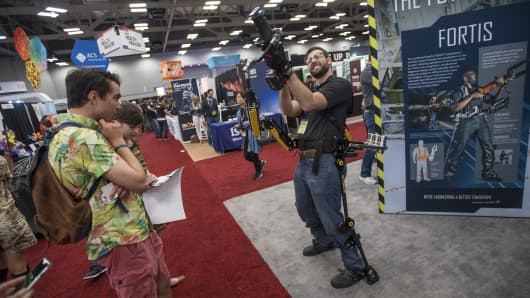 An exhibitor demonstrates a Lockheed Martin FORTIS exoskeleton at the 2017 South By Southwest (SXSW) Interactive Festival at the Austin Convention Center in Austin, Texas, U.S., on Tuesday, March 14, 2017.