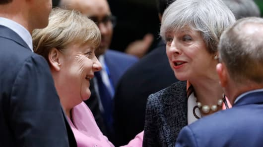 British Prime Minister Theresa May and German Chancellor Angela Merkel attend the EU summit in Brussels, Belgium, March 9, 2017.