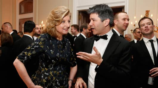Arianna Huffington, co-founder and editor-in-chief of the Huffington Post, left, and Travis Kalanick, co-founder and chief executive officer of Uber Technologies Inc.