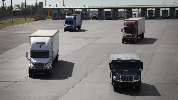Trucks, including an armored car, pass through U.S. customs on October 17, 2016 in Laredo, Texas. South Texas customs agents processed $166 billion in imports from Mexico last year, with the largest amount coming through Laredo.