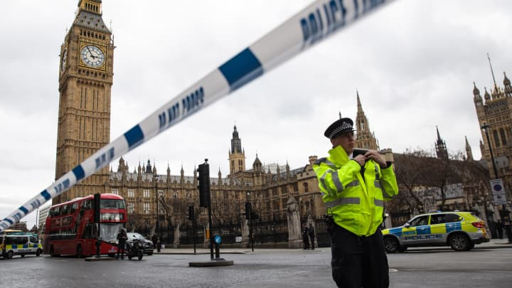 A police officer stands guard near Westminster Bridge and the Houses of Parliament on March 22, 2017 in London, England.