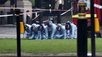 Police forensic officers work in Parliament Square following yesterday's attack, on March 23, 2017 in London, England.