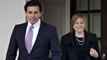Mary Barra, CEO of General Motors, center, and Mark Fields, president and CEO of Ford Motor, arrive to a news conference outside the White House after a meeting with President Donald Trump, not pictured, in Washington on Tuesday, Jan. 24, 2017.