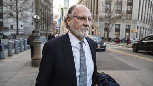 Jon Corzine, former chairman of MF Global Holdings Ltd., exits district court in New York, on Thursday, March 9, 2017.