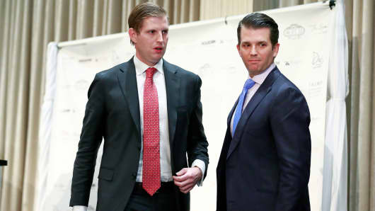 Donald Trump Jr. (R) and his brother Eric Trump leave the stage after a ceremony for the official opening of the Trump International Hotel & Tower on February 28, 2017 in Vancouver, Canada.