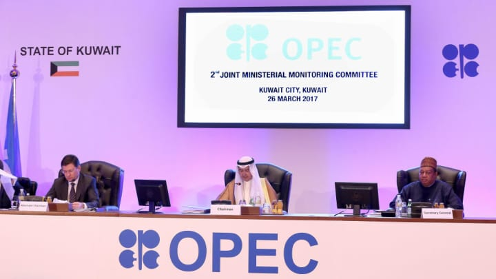 (L to R) Russian Energy Minister Alexander Novak, Kuwait's Oil Minister Essam al-Marzouq and OPEC secretary general Mohammad Sanusi Barkindo attend a meeting for the 2nd Joint Ministerial Monitoring Committee of OPEC, in Kuwait City, on March 26, 2017.
