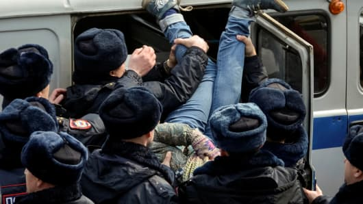 Police officers detain an opposition supporter during a rally in Vladivostok, Russia, March 26, 2017