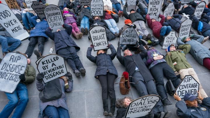Activists gathered near Brooklyn Borough Hall where the staged a rally and symbolic 'die-in' in opposition to the repeal of the Affordable Care Act (ACA) and its replacement by Republican-authored legislation currently under proposal in the US House of Representatives.