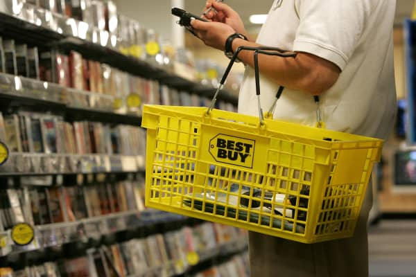 A salesman carries a Best Buy shopping basket in San Francisco, California.