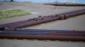 Pipeline leading to the Syncrude Canada Ltd. upgrader plant sits at the company's mine near Fort McMurray, Alberta, Canada.