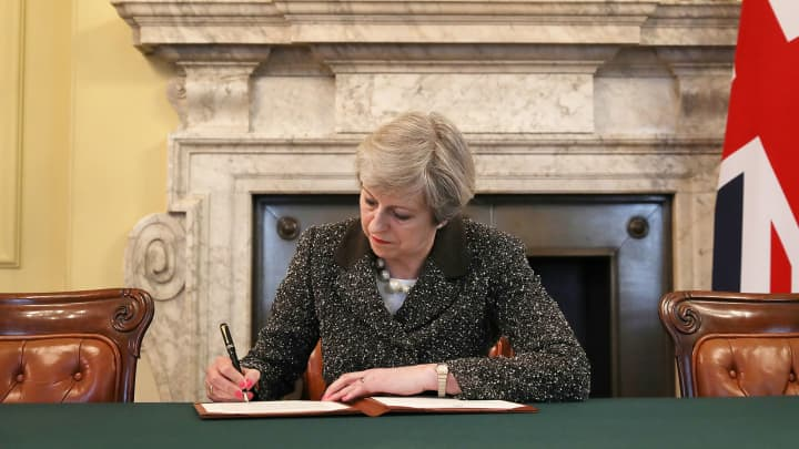 British Prime Minister Theresa May signs the official letter to European Council President Donald Tusk invoking Article 50 and the United Kingdom's intention to leave the EU on March 28, 2017 in London.