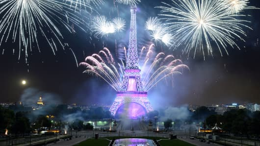Fireworks explode around the Eiffel Tower during the annual Bastille Day celebrations.