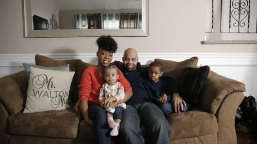 Greg Walton with his wife, Alicia, and two children, Gia Jalise and Gregory Jr.
