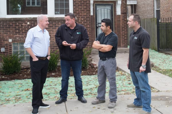 Sean Conlon, Bryan Sonn, a subcontractor, Mark Ainley (L to R).