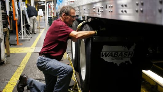A worker assembles a semi trailer on the factory floor at the Wabash National Corp. manufacturing facility in Lafayette Indiana