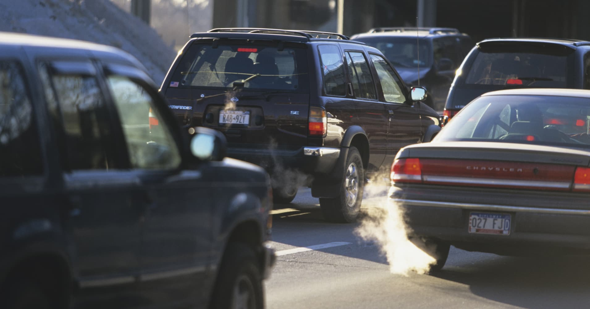 Auto industry titans say they're still committed to cutting emissions