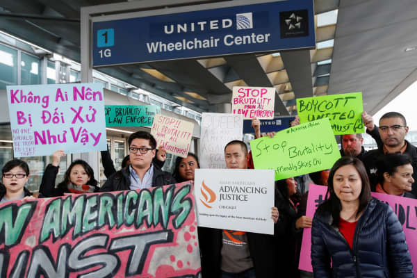 Community members protest the treatment of Dr. David Dao, who was forcibly removed from a United Airlines flight on Sunday by the Chicago Aviation Police, at O'Hare International Airport in Chicago, April 11, 2017.
