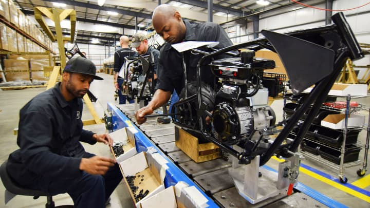 Workers construct mini-bikes at motorcycle and go-kart maker Monster Moto in Ruston, Louisiana.