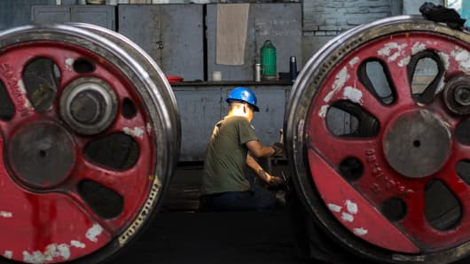 Workers at a maintenance factory for steam locomotives in Fuxin, located in China's northeast Liaoning Province.