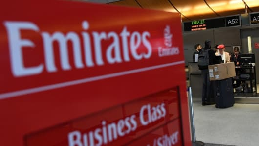 A passenger buys a ticket at a Emirates Airline counter in Los Angeles International Airport in Los Angeles, California on March 21, 2017.