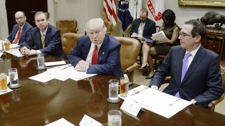 President Donald Trump discusses the federal budget as Treasury Secretary Steve Mnuchin (R) looks on in the Roosevelt Room of the White House on February 22, 2017 in Washington, DC.