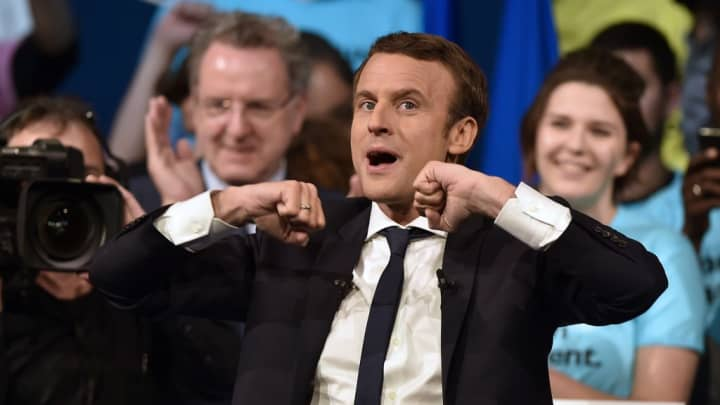 rench presidential election candidate for the En Marche ! movement Emmanuel Macron reacts on stage at the end of a campaign meeting in Nantes, on April 19, 2017.