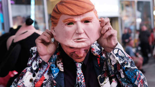 A Times Square performer works in a Donald Trump mask on October 17, 2016 in New York City.