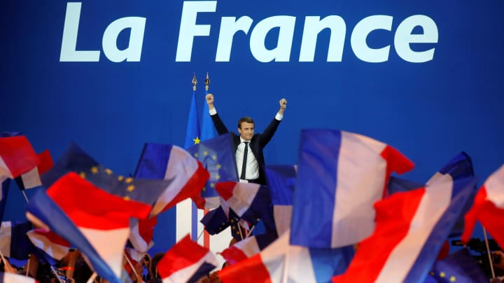 Emmanuel Macron, head of the political movement En Marche !, or Onwards !, and candidate for the 2017 French presidential election, celebrates on stage at the Parc des Expositions hall in Paris after partial results in the first round of 2017 French presidential election, France, April 23, 2017.