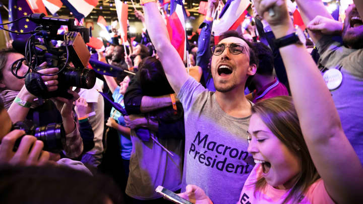Founder and Leader of the political movement 'En Marche !' and presidential candidate Emmanuel Macron (not pictured) addresses activists after the announcement of the French presidential Election results on April 23, 2017 in Paris, France.