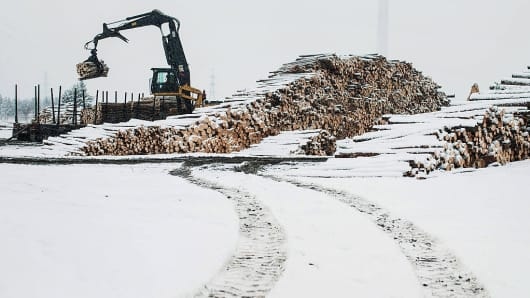 Raw lumber is unloaded from a truck at the Resolute Forest Products mill in Thunder Bay, Canada, Ontario, on Friday, Jan. 8, 2016.