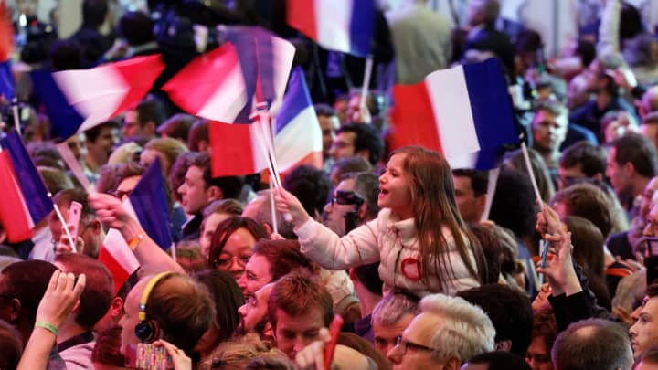 Supporters of founder and Leader of the political movement 'En Marche !' Emmanuel Macron celebrates after winning the lead percentage of votes in the first round of the French Presidential Elections at Parc des Expositions Porte de Versailles on April 23, 2017 in Paris, France.