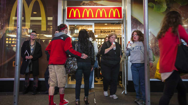 Customers enter and exit a McDonald's Corp. restaurant in Times Square in New York.