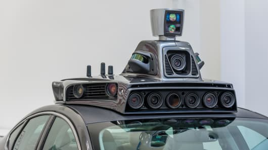 The cameras on a pilot model of an Uber self-driving car are displayed at the Uber Advanced Technologies Center.