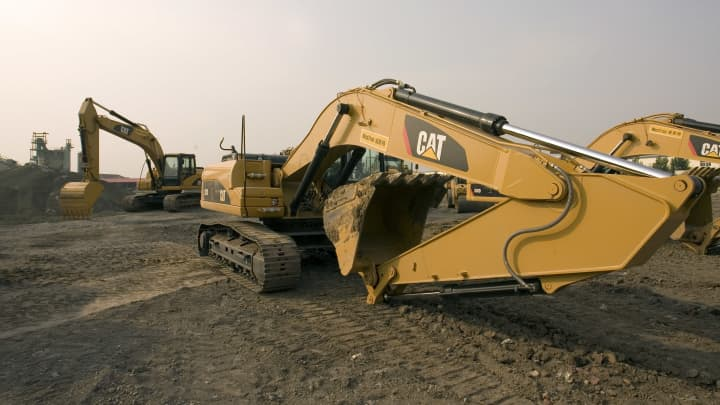 Machinery made by Caterpillar Inc. operates at a demonstration in Tianjin, China.