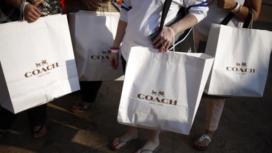 coach prime outlets xqcc  Customers carry Coach Inc shopping bags after shopping at a store during a  charity preview