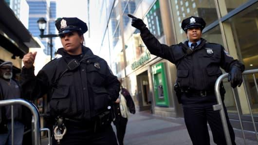 Police officers direct pedestrians in Philadelphia.