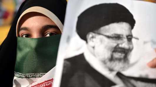 Supporters of Iranian cleric and presidential candidate Ebrahim Raisi vawe Iranian flags during Raisi's electoral rally prior to presidential elections in Tehran, Iran on April 29, 2017.