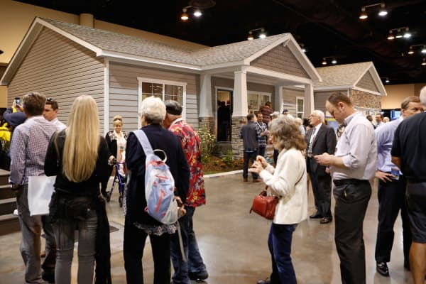 Shareholders outside model homes at the 2017 Berkshire Hathaway Annual Meeting in Omaha, NE.