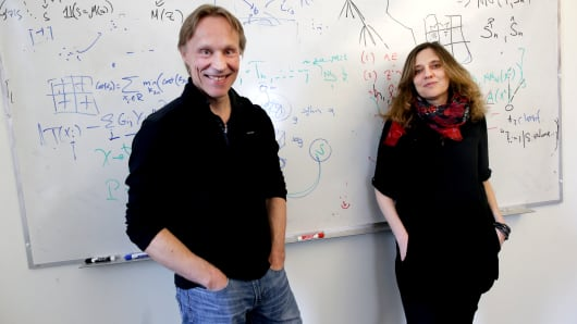 MIT Professors Tommi Jaakkola, left, and Regina Barzilay poses for a portrait in Cambridge, MA on Apr. 5, 2017. They teach a popular course on machine learning.