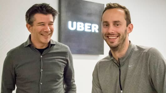 Uber CEO Travis Kalanick left and Anthony Levandowski co-founder of Otto pose for