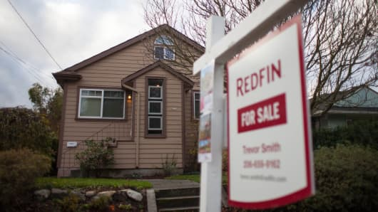 A Redfin Corp. 'For Sale' sign stands outside of a home in Seattle, Washington.