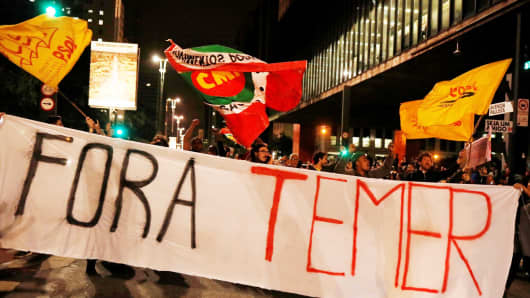 "Demonstrators protest against Brazil's President Michel Temer in Sao Paulo, Brazil, May 17, 2017. The banner reads: ""Out Temer."""