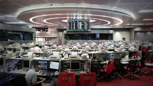 A trader is seen on the floor of the Hong Kong Stock Exchange.