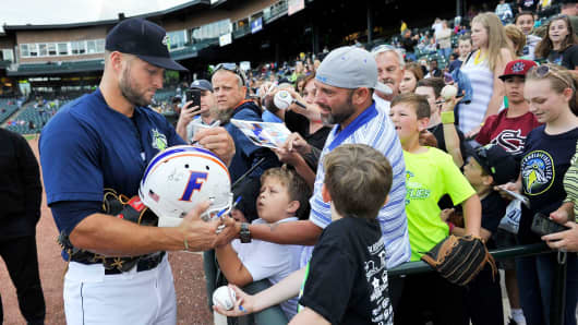 Tim Tebow of the Columbia Fireflies signs a Florida Gators helmet before a game against the Lakewood BlueClaws on Saturday, May 6, 2017, at Spirit Communications Park in Columbia, South Carolina.