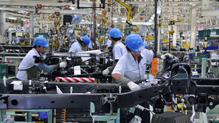 Workers labor on the production line at the Mitsubishi Motors (Thailand) Co. factory in Laem Chabang, Chonburi Province, Thailand.