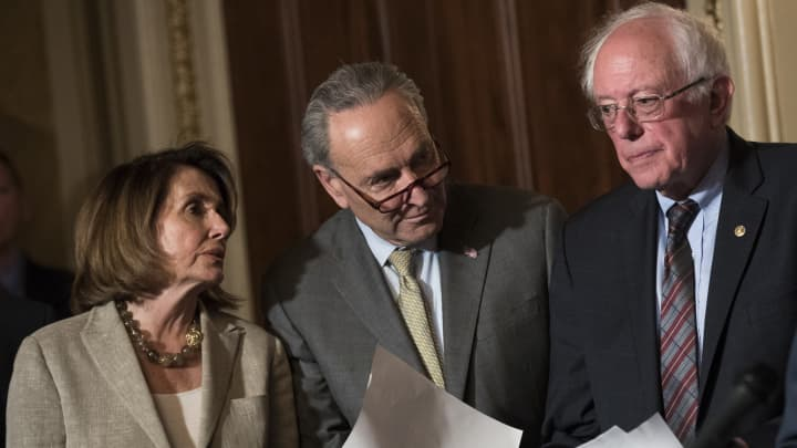 House Minority Leader Nancy Pelosi (D-CA), Senate Minority Leader Chuck Schumer (D-NY), and Sen. Bernie Sanders (D-VT) confer during a press conference to discuss legislation for a 15 dollar minimum wage, on Capitol Hill, May 25, 2017 in Washington, DC.